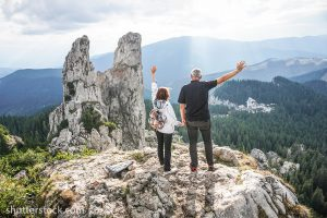 IMPROVE Physical Therapy Elderly Hiking On Mountain Top